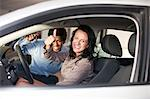 Woman buying new car from salesman Stock Photo - Premium Royalty-Free, Artist: Ikon Images, Code: 614-06623956