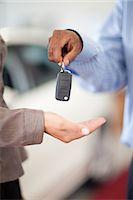 services - Salesman handing woman new car keys Stock Photo - Premium Royalty-Freenull, Code: 614-06623963