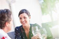 Couple having drinks together outdoors Stock Photo - Premium Royalty-Freenull, Code: 614-06623981