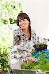 Woman potting plants outdoors Stock Photo - Premium Royalty-Free, Artist: ableimages, Code: 614-06624054