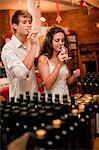 Couple tasting wine in grocery Stock Photo - Premium Royalty-Free, Artist: Blend Images, Code: 614-06624084