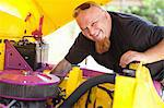 Mechanic working on colorful car Stock Photo - Premium Royalty-Free, Artist: Blend Images, Code: 614-06624114