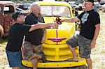 Men drinking beer by colorful car Stock Photo - Premium Royalty-Free, Artist: Cultura RM, Code: 614-06624117