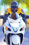 Blurred view of man riding motorcycle Stock Photo - Premium Royalty-Free, Artist: Aflo Relax, Code: 614-06624126