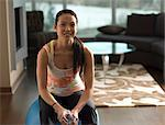 Woman sitting on exercise ball Stock Photo - Premium Royalty-Free, Artist: Aflo Relax, Code: 614-06624255