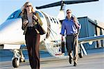 Business people on airplane runway Stock Photo - Premium Royalty-Free, Artist: Blend Images, Code: 614-06624360