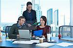 Business people working at desk Stock Photo - Premium Royalty-Free, Artist: Glowimages, Code: 614-06624376