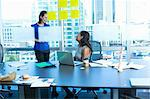 Businesswomen talking in office Stock Photo - Premium Royalty-Free, Artist: Glowimages, Code: 614-06624388