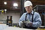Worker with gloves in metal plant Stock Photo - Premium Royalty-Free, Artist: ableimages, Code: 614-06624475