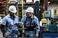 production - Workers talking in metal plant Stock Photo - Premium Royalty-Freenull, Code: 614-06624497