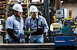 Workers talking in metal plant Stock Photo - Premium Royalty-Free, Artist: Cultura RM, Code: 614-06624498