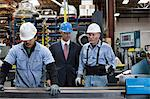 Workers and businessman in metal plant Stock Photo - Premium Royalty-Free, Artist: Cultura RM, Code: 614-06624499