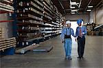 Worker and businessman in metal plant Stock Photo - Premium Royalty-Free, Artist: Cultura RM, Code: 614-06624501