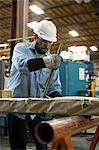 Worker using machinery in metal plant Stock Photo - Premium Royalty-Free, Artist: CulturaRM, Code: 614-06624526