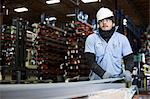 Worker holding sheet in metal plant Stock Photo - Premium Royalty-Free, Artist: Blend Images, Code: 614-06624528