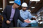 Worker and businessman in metal plant Stock Photo - Premium Royalty-Free, Artist: Blend Images, Code: 614-06624540