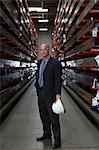 Businessman standing in metal plant Stock Photo - Premium Royalty-Free, Artist: Michael Mahovlich, Code: 614-06624544