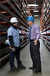Worker and businessman in metal plant Stock Photo - Premium Royalty-Free, Artist: Blend Images, Code: 614-06624549