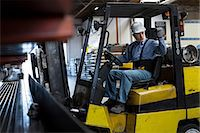 switchboard operator - Worker using forklift in metal plant Stock Photo - Premium Royalty-Freenull, Code: 614-06624564