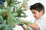 Boy decorating Christmas tree Stock Photo - Premium Royalty-Free, Artist: Susan Findlay, Code: 614-06624571