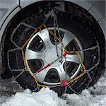 Close up of snow chains on car tire Stock Photo - Premium Royalty-Free, Artist: CulturaRM, Code: 614-06624574
