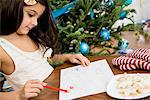 Girl writing letter to Santa at table Stock Photo - Premium Royalty-Free, Artist: Robert Harding Images, Code: 614-06624580