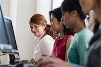 Businesswomen working at computers Stock Photo - Premium Royalty-Freenull, Code: 614-06624658