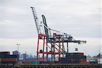 Crane and containers on loading dock Stock Photo - Premium Royalty-Freenull, Code: 614-06624696