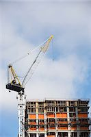 Crane over building in construction Stock Photo - Premium Royalty-Freenull, Code: 614-06624720