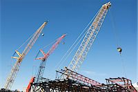 Colorful cranes against blue sky Stock Photo - Premium Royalty-Freenull, Code: 614-06624736