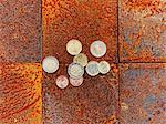 Euro coins on brick floor Stock Photo - Premium Royalty-Free, Artist: Cultura RM, Code: 614-06624828