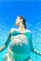 pregnant low angle - Pregnant woman in swimming pool Stock Photo - Premium Royalty-Freenull, Code: 614-06624892