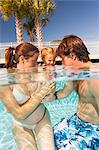 Parents and toddler in swimming pool
