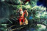 Santa Christmas ornament on tree Stock Photo - Premium Royalty-Free, Artist: Robert Harding Images, Code: 614-06624916