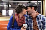 Couple kissing on urban subway Stock Photo - Premium Royalty-Free, Artist: Blend Images, Code: 614-06624984