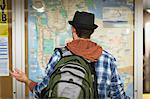 Confused man reading city map Stock Photo - Premium Royalty-Free, Artist: Ascent Xmedia, Code: 614-06624988