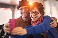Couple taking picture with cell phone Stock Photo - Premium Royalty-Freenull, Code: 614-06625004