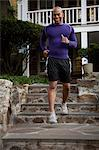 Man jogging on steps outdoors Stock Photo - Premium Royalty-Free, Artist: Blend Images, Code: 614-06625035