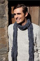 Smiling man wearing scarf outdoors Stock Photo - Premium Royalty-Freenull, Code: 614-06625059