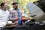 Men grilling kebabs outdoors Stock Photo - Premium Royalty-Free, Artist: Cultura RM, Code: 614-06625071