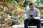 Man using cell phone outdoors Stock Photo - Premium Royalty-Free, Artist: Blend Images, Code: 614-06625092