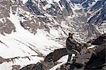 Hiker walking on rocky mountainside Stock Photo - Premium Royalty-Free, Artist: Uwe Umsttter, Code: 614-06625128