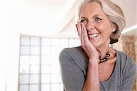 portrait smile caucasian one - Smiling older woman gasping Stock Photo - Premium Royalty-Freenull, Code: 614-06625159