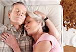 Older couple napping on sofa Stock Photo - Premium Royalty-Free, Artist: Blend Images, Code: 614-06625176