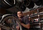 Mechanic working in bicycle shop Stock Photo - Premium Royalty-Free, Artist: Blend Images, Code: 614-06625215
