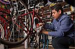 Mechanic working in bicycle shop Stock Photo - Premium Royalty-Free, Artist: Aflo Relax, Code: 614-06625218