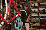 Mechanic working in bicycle shop Stock Photo - Premium Royalty-Free, Artist: Blend Images, Code: 614-06625221