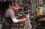 Mechanic working in bicycle shop Stock Photo - Premium Royalty-Free, Artist: Blend Images, Code: 614-06625230