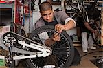 Mechanic working in bicycle shop Stock Photo - Premium Royalty-Free, Artist: Blend Images, Code: 614-06625236