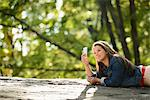 Woman taking picture with cell phone Stock Photo - Premium Royalty-Free, Artist: AlaskaStock, Code: 614-06625371